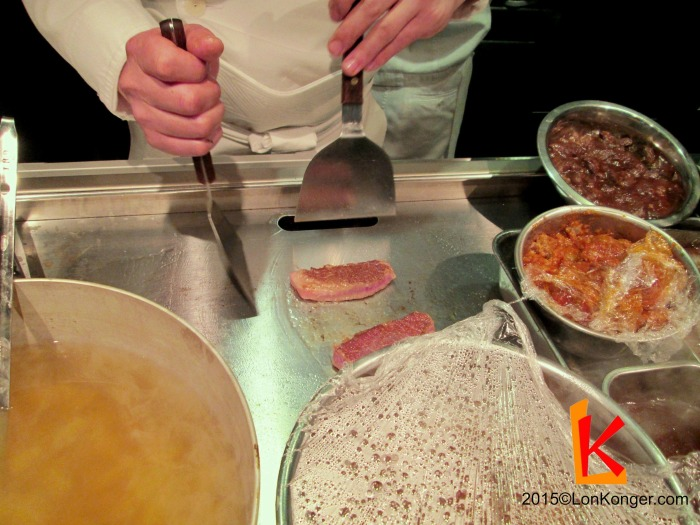 Grilling the Kobe beef on a griddle (teppan)